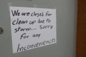 A sign was placed on the door of Kisavos Bar and Grill on Aug. 9, 2017, turning customers away due to flood repairs. (Chris Vandenbreekel/650 CKOM)