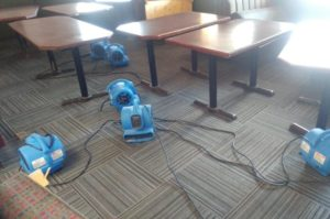 The owners of Kisavos set up several machines to help dry the carpets of their restaurant on Aug. 9, 2017.