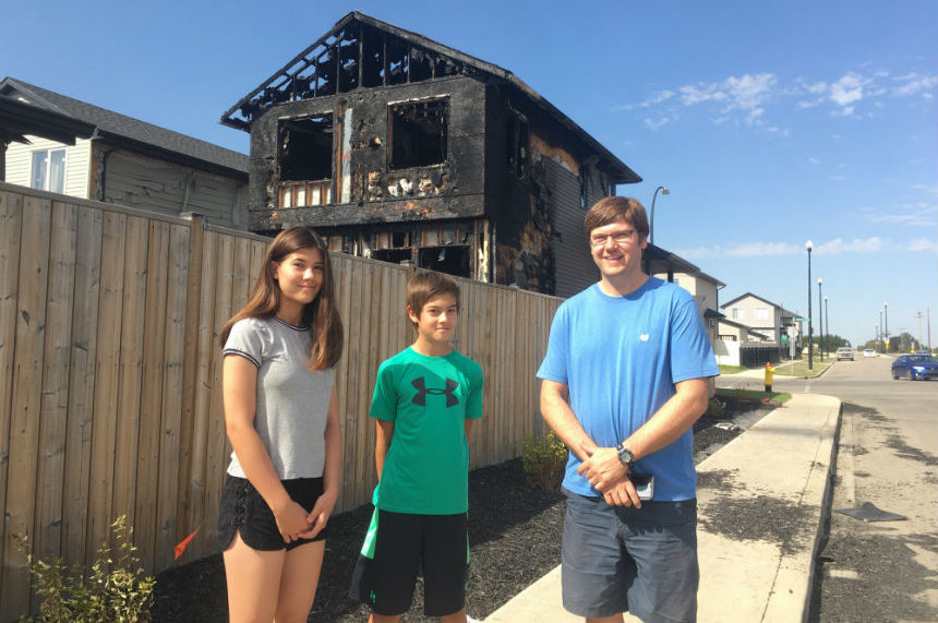 Two kids run toward danger to warn neighbours of house fire