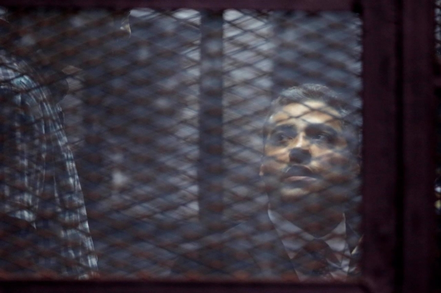 Canadian journalist Mohamed Fahmy pardoned by president in Egypt