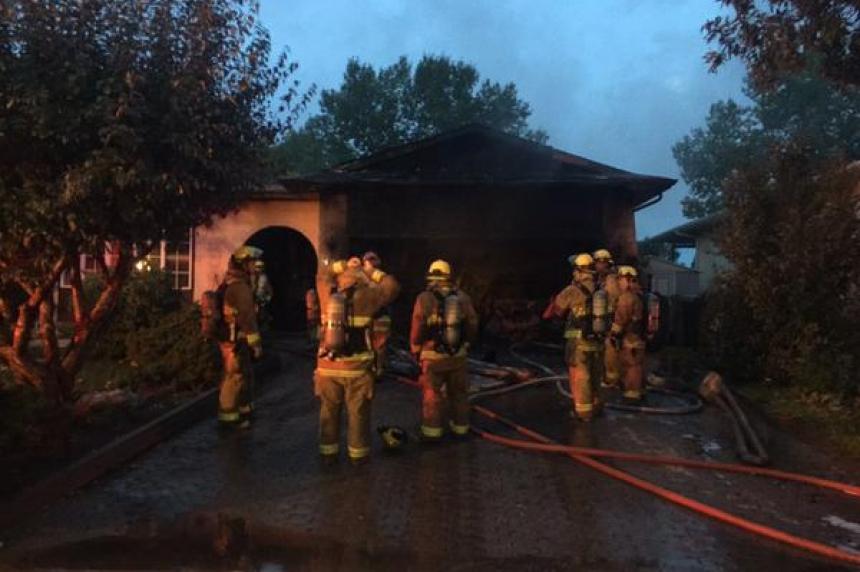 Garage fire wakes family in northwest Regina