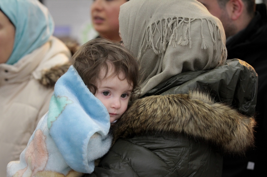 Applause, song welcome 3 Syrian refugee families to Saskatoon