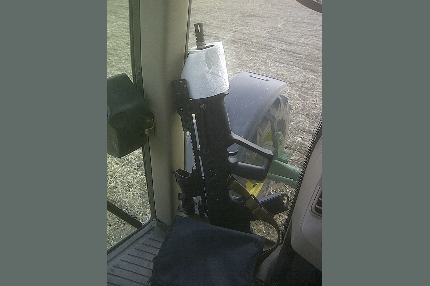 Farmer says many online gun photos result ofprank