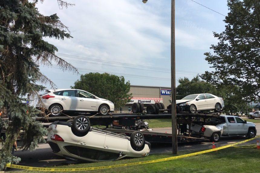 Collision spills cars off trailer in north Saskatoon