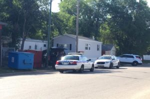 Saskatoon police arrest one person after a standoff on 11th Street W on Monday. (Celine Grimard/650 CKOM)