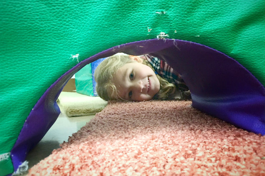 A child peeks through play blocks at Prince Philip preschool on Nov. 16, 2017. (Daniella Ponticelli/650 CKOM)