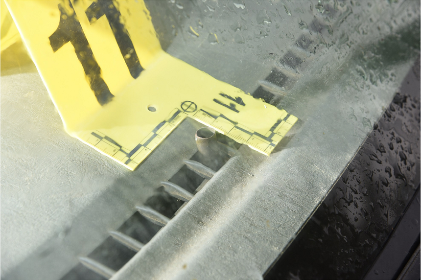 """A bullet casing with the marking """"BXN 53"""" was found resting in the dashboard heating vent of the grey SUV Colten Boushie's body was found near. An agreed statement of facts in court says the casing came from Gerald Stanley's Tokarev handgun. (RCMP)"""