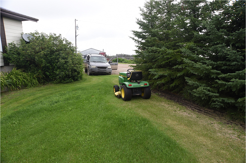The grey SUV Colten Boushie's body was found near rests feet away from a riding lawn mower on Gerald Stanley's farm. Stanley's son Sheldon told court his mother Leesa was mowing the lawn when the confrontation began. (RCMP)