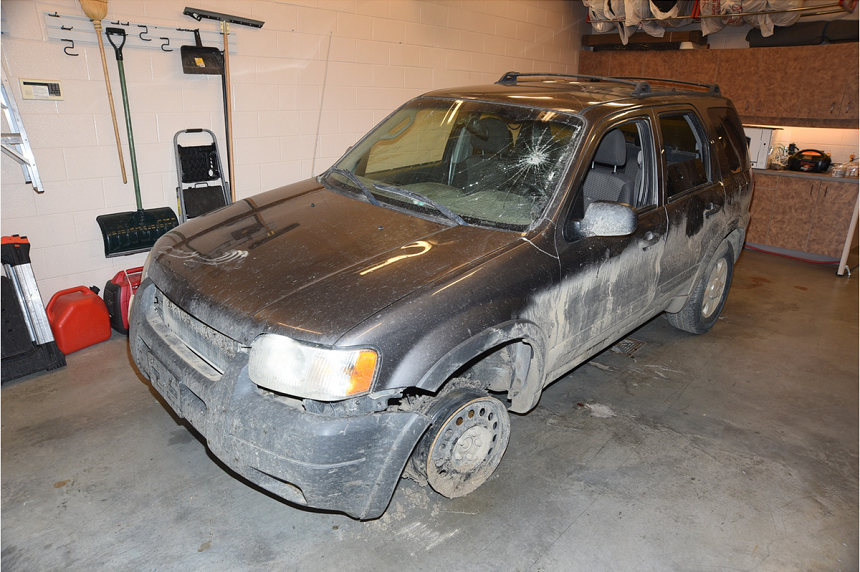 The grey SUV Colten Boushie's body was found near sits in an RCMP secure bay with a shredded front tire and broken windshield. Witnesses say the tire popped on a culvert, while Sheldon Stanley hit the windshield with a framing hammer. (RCMP)