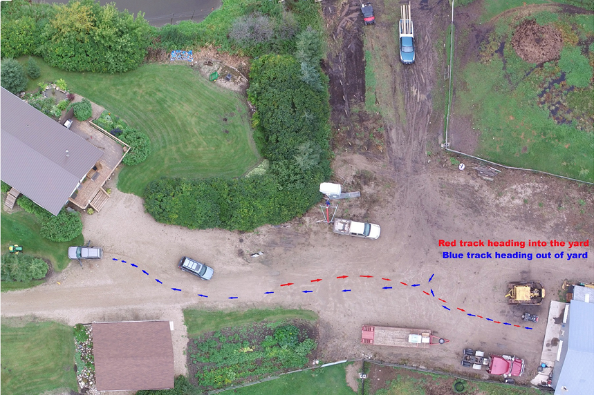 An overhead shot of Stanley's farm indicates the path the grey SUV took when it entered the yard, according to tire tracks. A blue line shows the path they took to exit, leading to where the SUV stopped. (RCMP)