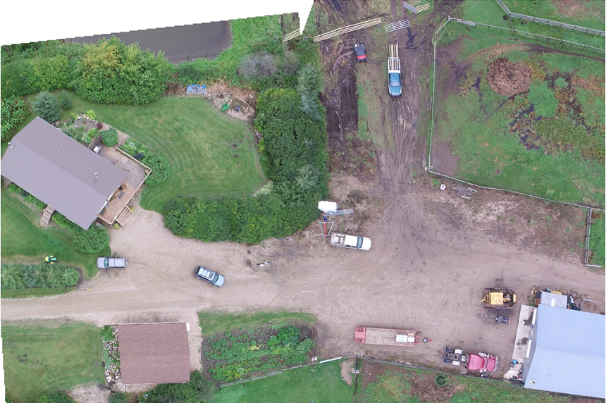 An overhead composite shot of Gerald Stanley's farmyard shows the quad court has heard was started, along with the blue Ford Escape the grey SUV collided with in the middle. The SUV Colten Boushie was found in rests on the edge of the lawn on the left. (RCMP)