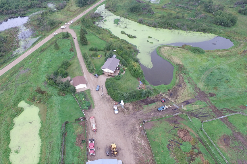 Another angle of Gerald Stanley's farm shows the quad on the bottom of the photo, with the grey SUV Colten Boushie was found near towards the top of the photo. RCMP vehicles can be seen at the grid road entrance. (RCMP)