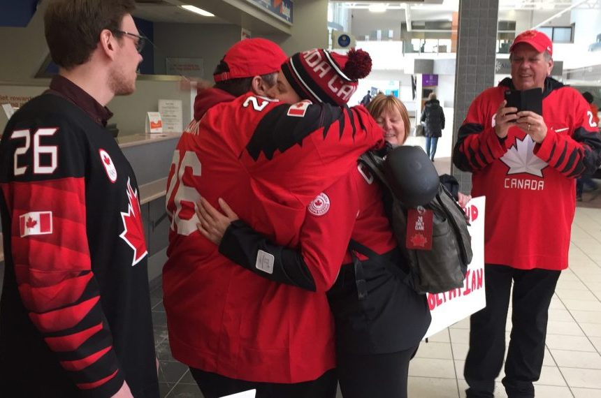Olympian Emily Clark hugs her brother Jeff after arriving home from the Pyeongchang winter games at the Saskatoon airport on Feb. 27, 2018. (Daniella Ponticelli/650 CKOM)