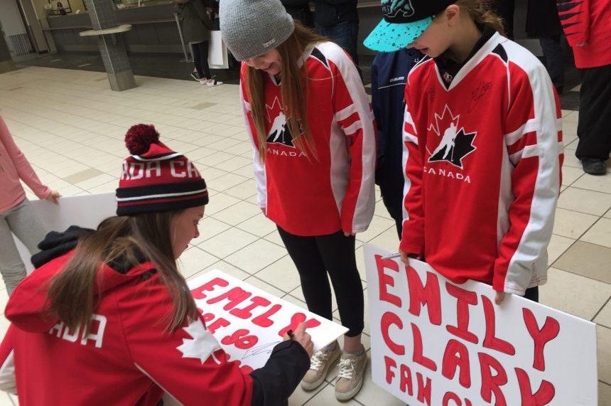 Olympian Emily Clark autographs signs for fans at the Saskatoon airport on Feb. 27, 2018. (Daniella Ponticelli/650 CKOM)