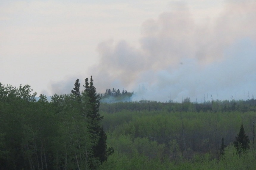 Wildfires still out of control, crews ready for dry weekend