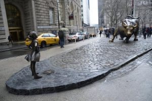Bronze statue of a girl facing Wall Street bull -- Darin Griffith