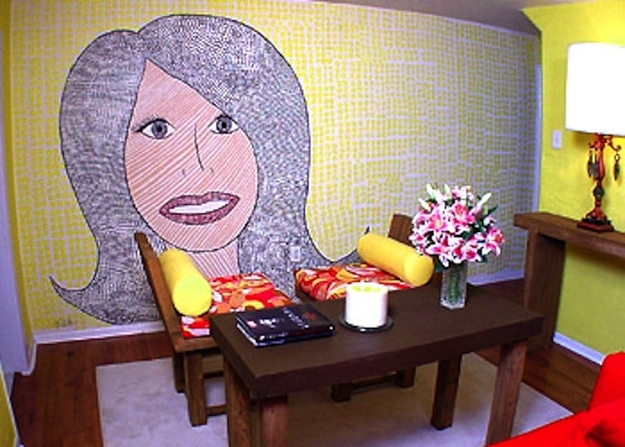 Hildi created a mural-mosaic of herself across a living room wall!  Now you'll have a reminder of the person who ruined your house!
