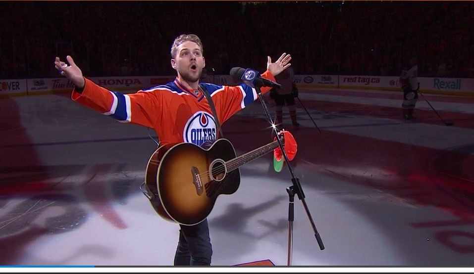 Brett Kissel recruits Oilers fans to sing US National Anthem after mic failure (Watch!...)
