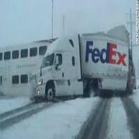 FedEx Truck hits Train