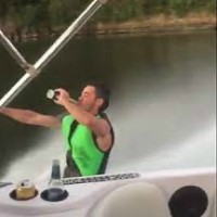 Waterskier faceplants while trying to ski and drink a beer
