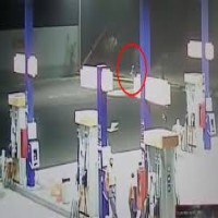 Alien at Gas Station