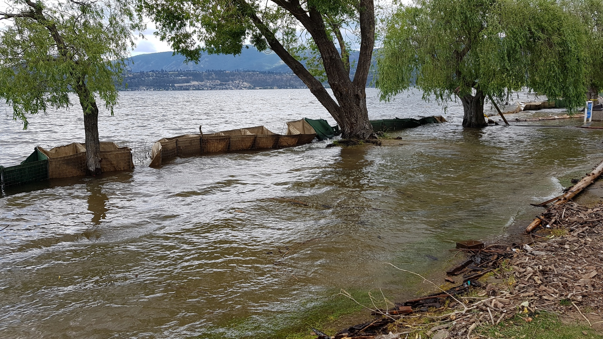 Flood Barriers Take A Beating, Back to Work in Victoria and Former Sheriff Deputy in Trouble