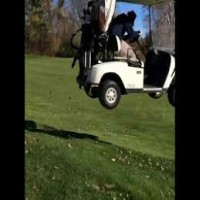 Golf cart jumps flower bed and lands hard