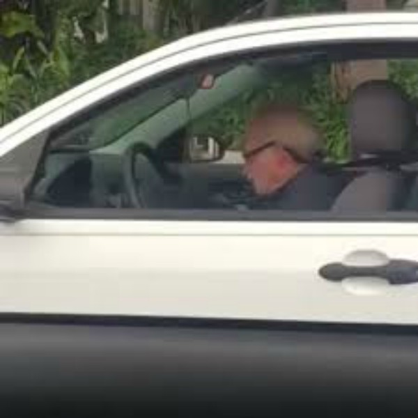 Old man headbanging to Metallica