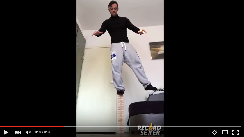 Guy Does A Full Squat Standing On A Jenga Tower You Have To See To Believe - WATCH