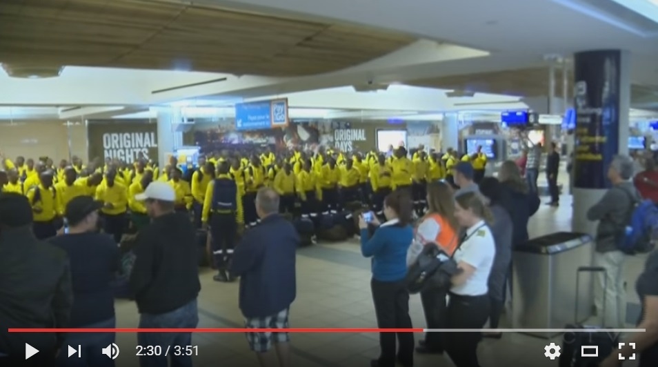 Heart Melting Scene As South African Firefighter's Arrive in Alberta and Dance In Airport Before Heading Out - WATCH