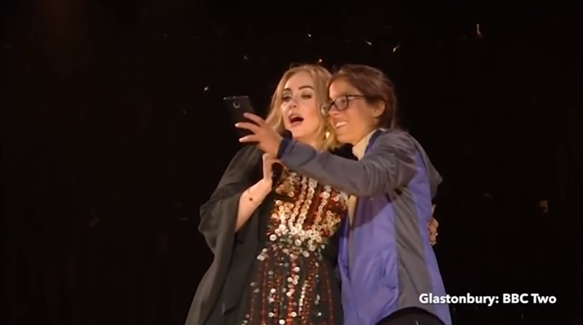 WATCH: Adele Burps on a fan then blames it on a 'Dirty Burger'!