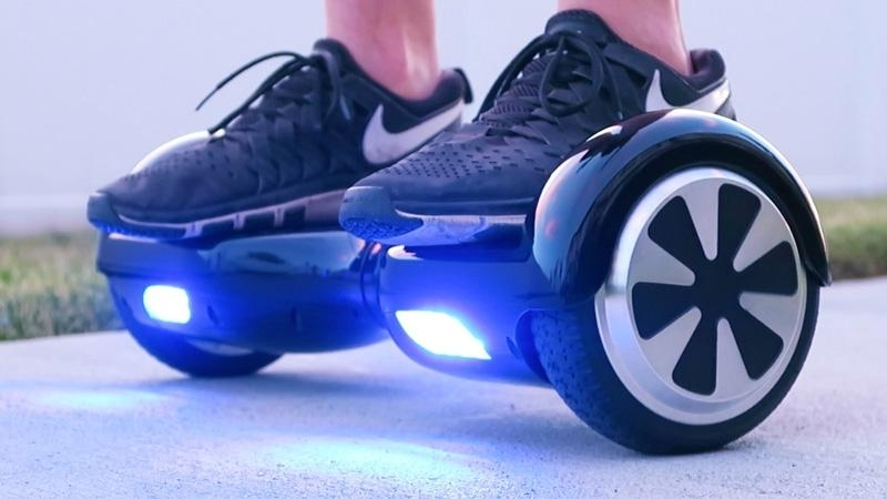 Guy uses a Hoverboard to push his wife around in her wheelchair.