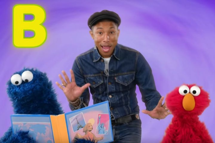The KID in me is SOOO Jealous... PHARRELL sings with Cookie Monster & Elmo! (WATCH)