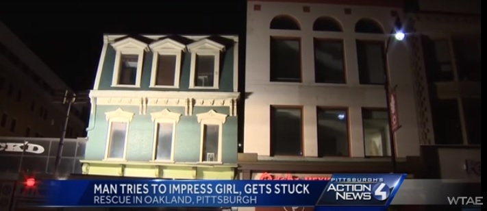 Guy tries to impress woman, gets stuck between two buildings