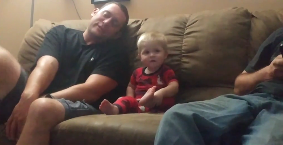 Little Boy Is The Cutest Copycat As He Mimics His Dad Stretching On The Couch - WATCH