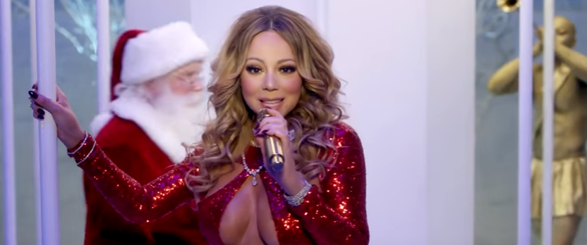 "WATCH: Mariah Carey releases new video for ""Here Comes Santa Claus""."