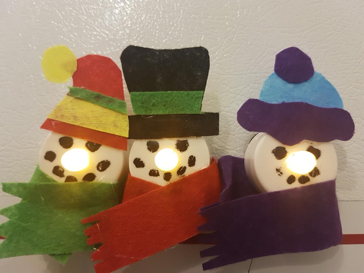 I Made Snowmen Magnets With Old Fake Tee Lights For Some Holiday Kitchen Cheer - FIND OUT HOW