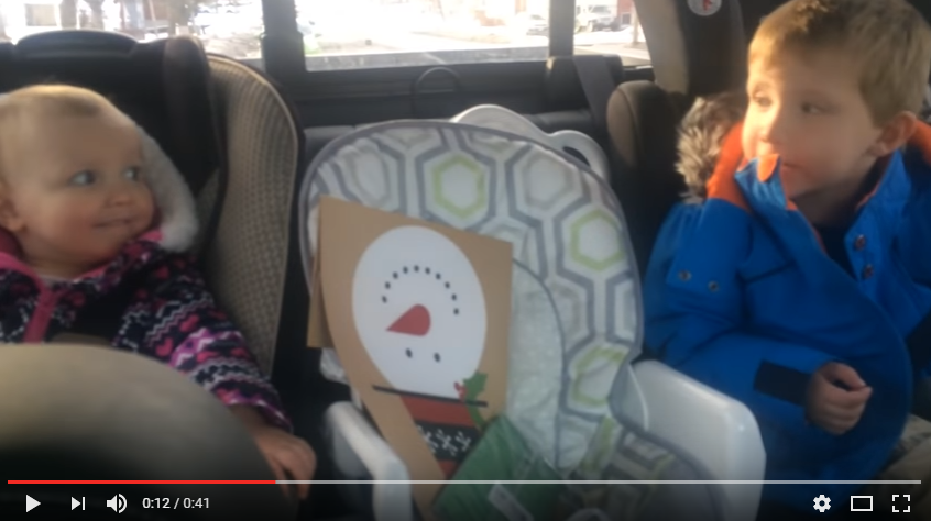 Brother Urges Baby Sister To Stop Adorably Swearing In Back Seat Of Car - WATCH