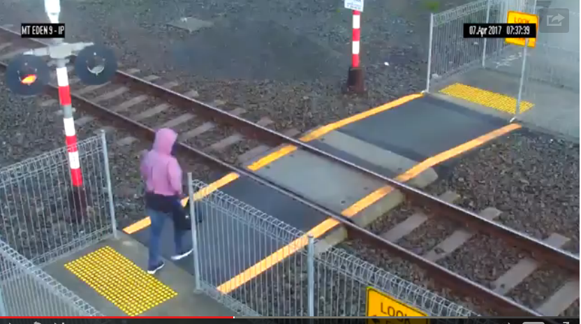 Woman Not Paying Attention Misses Getting Hit By Train By Just Centimeters - WATCH