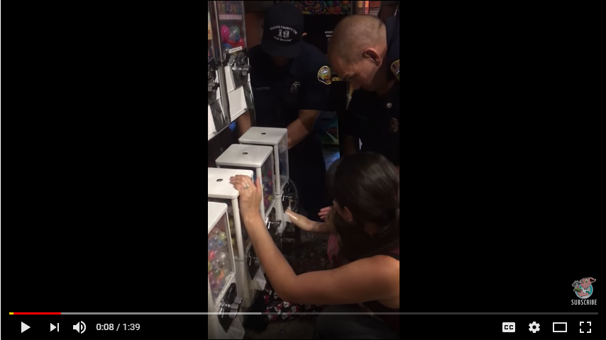 Paramedics free a little girl's arm that's stuck in a gumball machine. WATCH