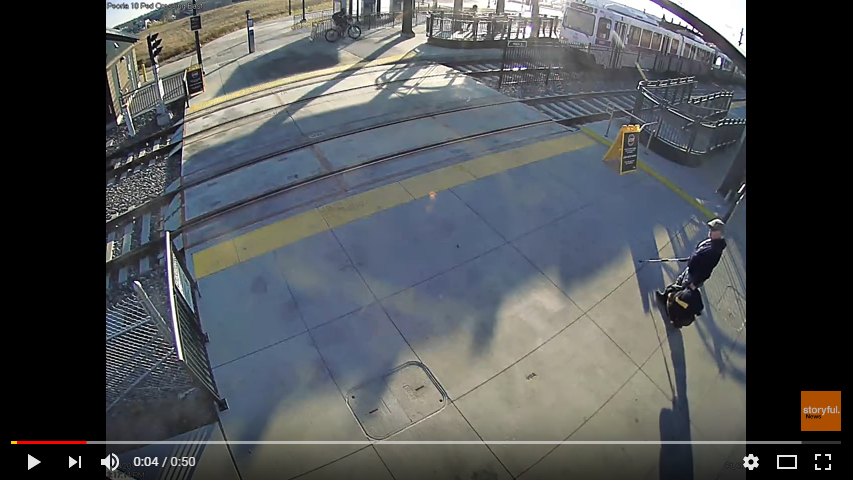 A stranger saves a blind man from walking into the path of a train. WATCH