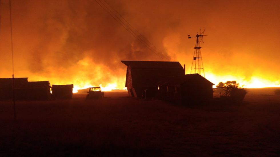 AT LEAST FOUR FARMS BURN BECAUSE OF THE WINDS AND WILDFIRES IN SOUTHERN ALBERTA YESTERDAY
