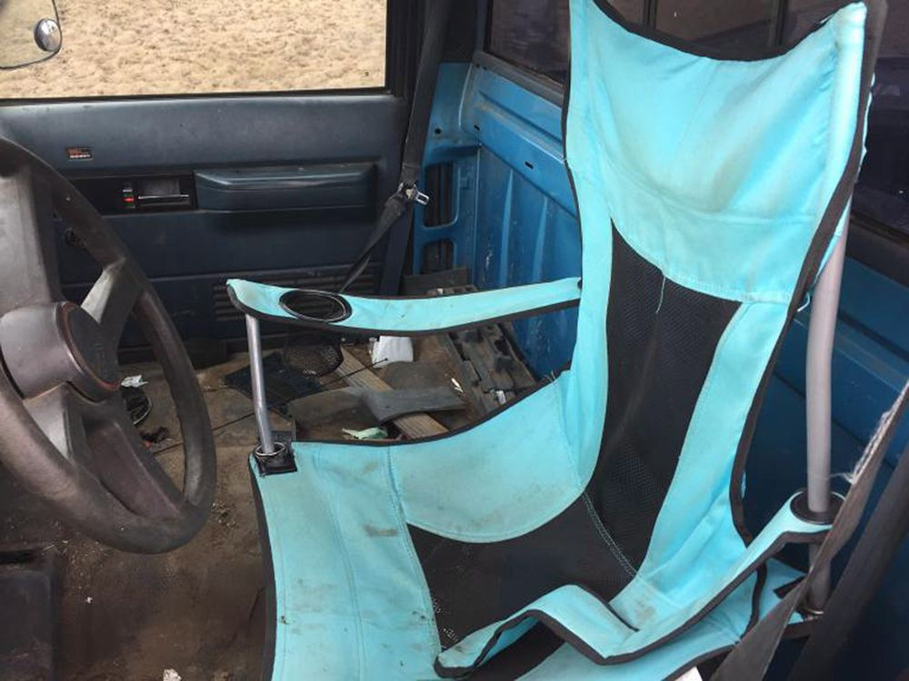 MAN PULLED OVER  BY POLICE--HAS A FOLDING LAWN CHAIR WHERE THE DRIVER'S SEAT SHOULD BE